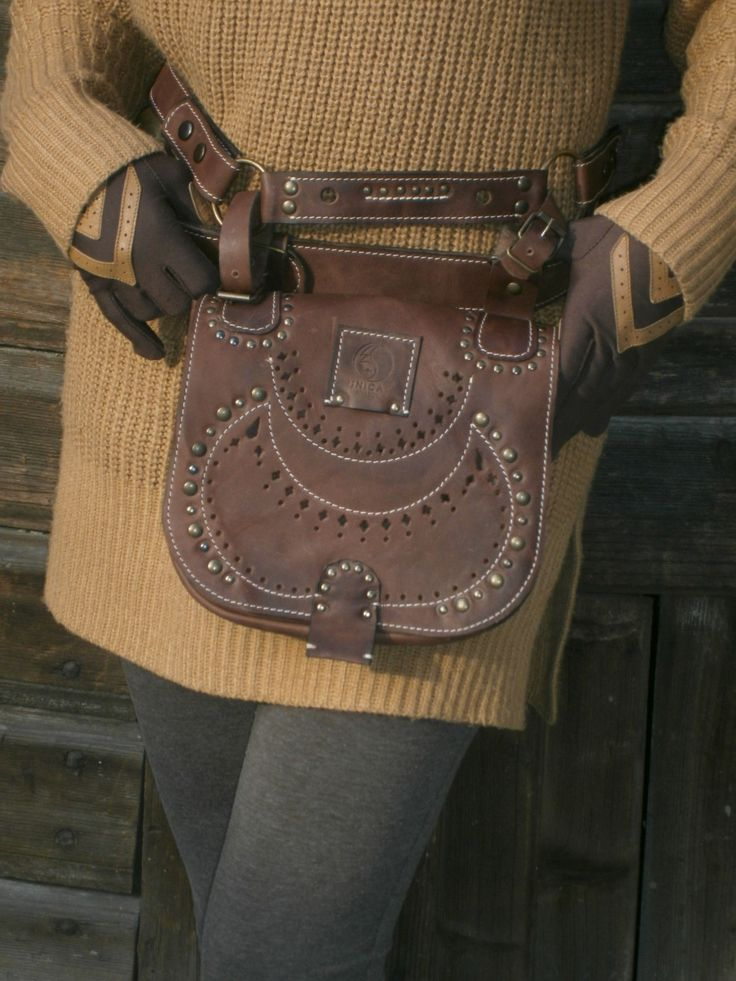 This is a gorgeous hipbag, with two belts, each one is different : one of them has buckle enclosure, another one with two eyelets on each size so it can be adjustable, and two rings. You can see on front sewing details and perforations specific to our country, Romania. It's size it's medium