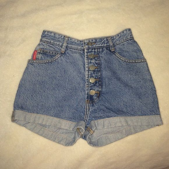 Vintage Bongo Jean Shorts Size 3; structured and thick jeans with rolled cuffs. In great condition. High waisted/button fly and kind of cheeky. Price is firm on these :) BONGO Shorts Jean Shorts
