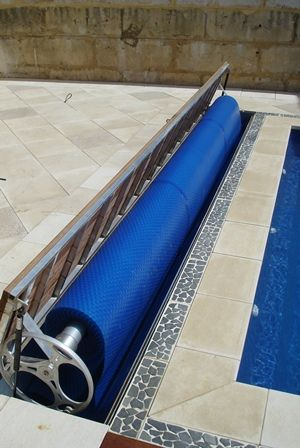Pool blanket roller is mounted to the Hideaway lid