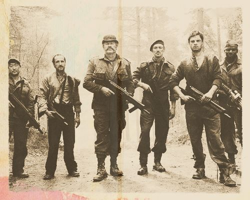 "The Howling Commandos: From left to right: Pvt. James Morita, Cpl. Jacques ""Frenchie"" Dernier, Cpl. Timothy Alyosius ""Dum Dum"" Dugan, Lt. James Montgomery Falsworth, Sgt. James Buchanan ""Bucky"" Barnes, Pvt. Gabriel ""Gabe"" Jones (Italy, November 1943)."