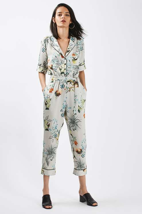 The playsuit looks to pyjama styling and oriental influence for the new season. Detailed with a sharp collar and half length button down placket fastening, this cropped style nips in at the waistline with a tie to flatter your shape. #Topshop