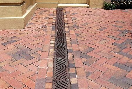 Fix poor #drainage areas with a french drain with grill. -- #Channel Drainage #HomeBegins at www.GreyDock.com