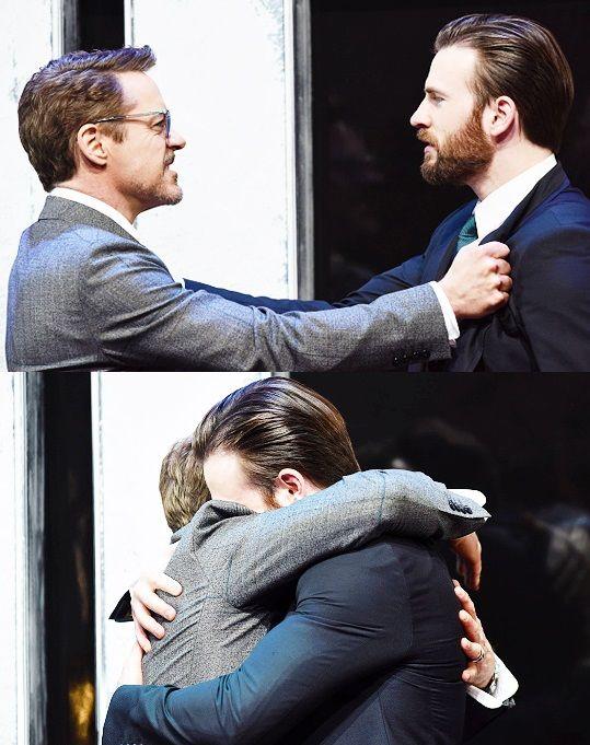 Robert Downey Jr. & Chris Evans on stage during the European film premiere of 'Captain America: Civil War' April 26, 2016 in London, England.