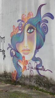 As Meninas dos Olhos Audiodescrição: Um grafite de Mari Pavanelli