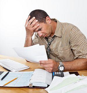 Worried Man with Debt and Bills by SalFalko, via Flickr
