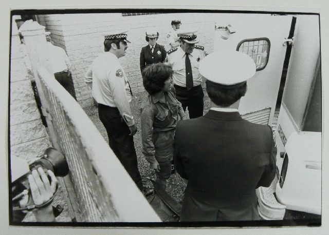 A woman being arrested during protests to save the Franklin River.