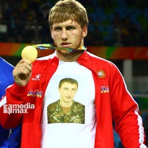 A story of one picture.... Arthur Aleksanian wins gold medal in RIO Olympics and dedicates his victory to all armenian soldiers who martyred in Artsakh during the April War and them who are serving for our country and keeping our borders impregnably today. ( While receiving his gold Aleksanian wore a shirt with the image of Robert Abajian who was killed in Artsakh during the April War) #rio2016 #rio #olympics #olympicgames #sport #nowar #artsakhisarmenia #wrestling #hero #heroes #armenia…