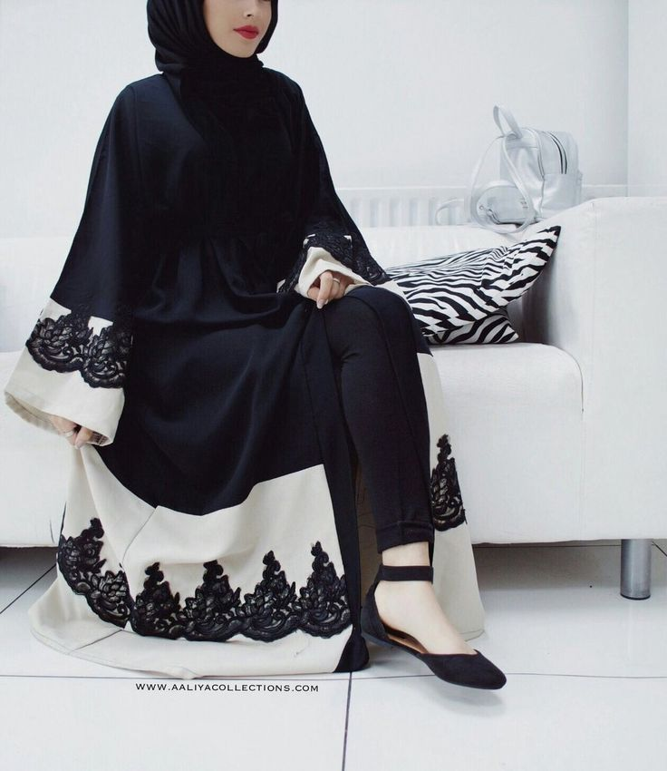 A beautiful black abaya with stunning lace patchwork embedded on cream crepe material at the bottom and at the sleeves of the abaya giving it high ...