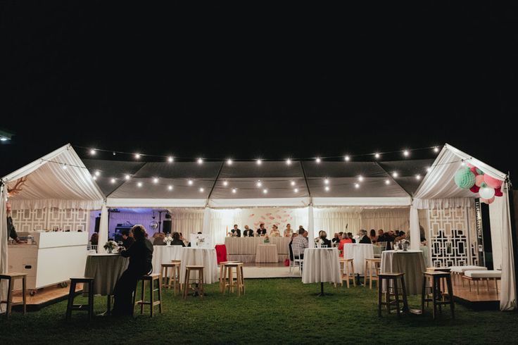 Wedding Reception | Marquee design featuring festoon lighting and timber bar stools. http://www.edeevents.com.au/marquees