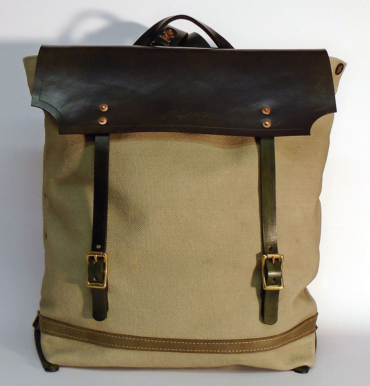 """Hand dyed cotton canvas backpack - khaki with jungle green leather strap  ● In case of order, please contact us with the following e-mail address: info@smithandscribeco.com ● Size: 5,5"""" x 13,8"""" x 17,3"""" - American ● 14 cm x 35 cm x 44 cm - European ● #canvasbackpack #handdyedcanvas #vintagebackpack #premiumingredients #highqualitycanvas #1920's #1930's #1940's"""