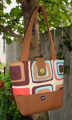 """THis is the Lucy bag, One of the first in the line. It is 11'widex4''d x 12"""" tal with a 28"""" strap.  There are 6 interior side pockets, including a very useful penpocket, This has a great button closure. and some fun fall colors. $55.oo"""