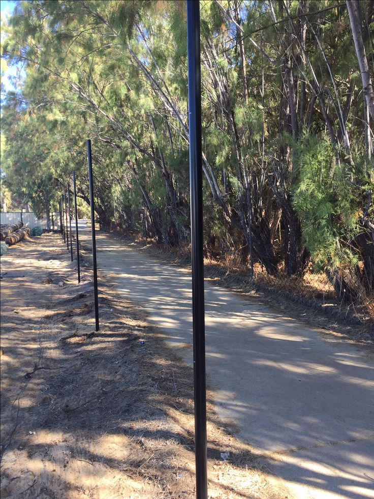 Black powder-coated posts set at South Perth Yacht Club for chainmesh install.