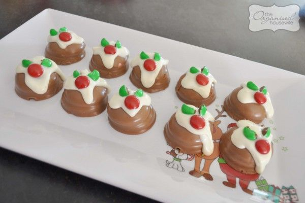 Cheats mini Christmas puddings using Arnotts Royals, white choc and red/green m+m's: