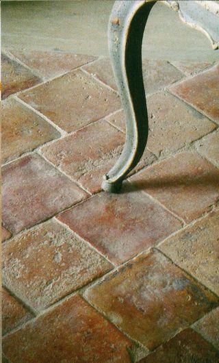 old terra cotta tile squares . . . . Entrance way?