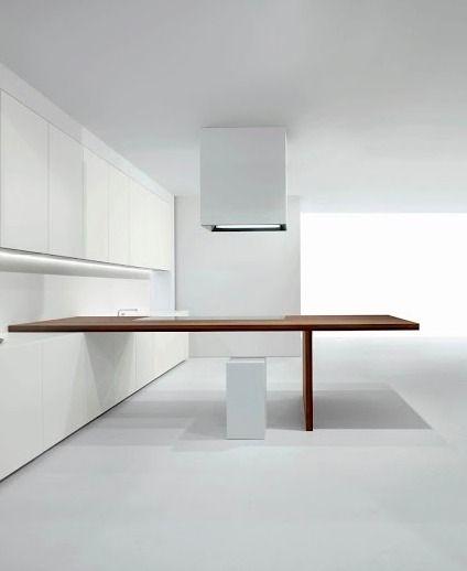 MK Cucine. White minimal kitchen with warm wooden counter top.