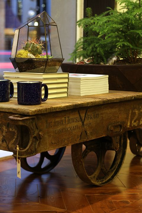 I see these at the Bouckville Flea Market each year and drool over them... love the industrial cart / coffee table on wheels!