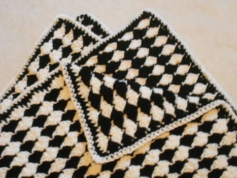 Black and white version of the Almost Reversible Shell Baby Blanket, lighter side up