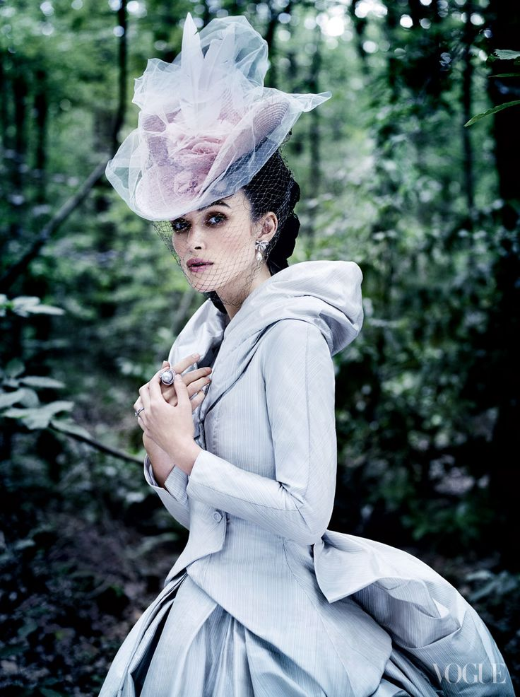"Knightley in one of her Anna Karenina costumes, designed by Jacqueline Durran. ""Enchanting was that lovely face,"" wrote Tolstoy of his creation. Sean Barrett straw hat. Chanel Fine Jewelry pearl-and-diamond earrings and ring."