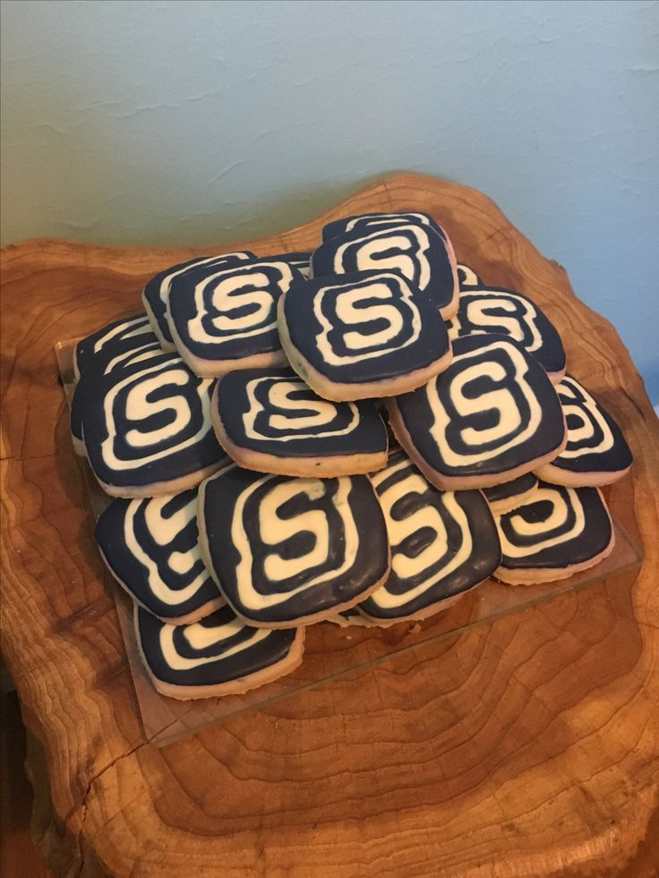 Logo sugar cookies for Skechers store grand opening. #sugarcookies #Skechers  #storegrandopening  #logo #cookiecutter #glazeicing #white #blue #decorated #custom #diy #homemade #dessert