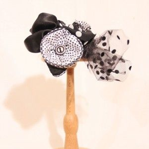 fas00011front1black satin fabric and black polka dot tulle on a teardrop-shaped base, decorated with black and white polka dots and black fabric flowers and details from white beads. - See more at: http://www.whereisthecat.gr/products/fascinator/black-satin-fascinator-hat-in-teardrop-shape-with-tulle/#sthash.IxkqCgwt.dpuf