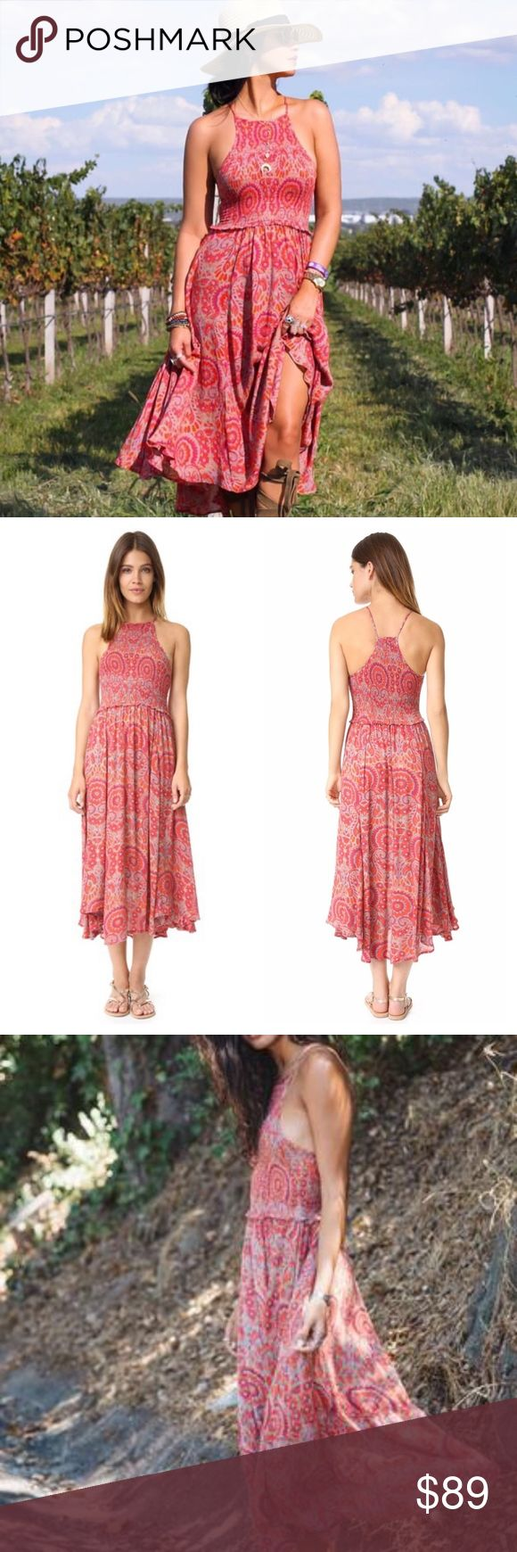 """Free People Red Combo 'Season In The Sun' Dress Gently shirred through the bodice, this summery slipdress has an easy shape and comfortable fit that's perfect for sun-soaked afternoons and balmy nights. Slips on over head. Great condition. Minor wear. No imperfections. Jewel neck. Unlined. 100% rayon. Halter.  smocked bodice Gathered skirt.  asymmetric hem. midi length V-racerback.  allover paisley and floral print. Measurements  Bust: 27"""" = 68.58 cm Waist: 25"""" = 63.5 cm Length: 44.75""""…"""