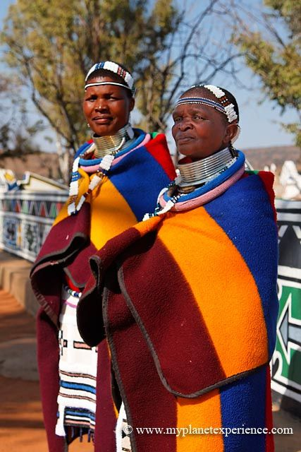 Africa | Ndebele women traditionally adorned themselves with a variety of ornaments, each symbolising her status in society. After marriage, dresses became increasingly elaborate and spectacular. In earlier times, the Ndebele wife would wear copper and brass rings around her arms, legs and neck, symbolising her bond and faithfulness to her husband, once her home was built.  South Africa | ©Image and caption My Planet Experience