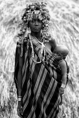Mursi woman with child, Ethiopia , August 12-2013