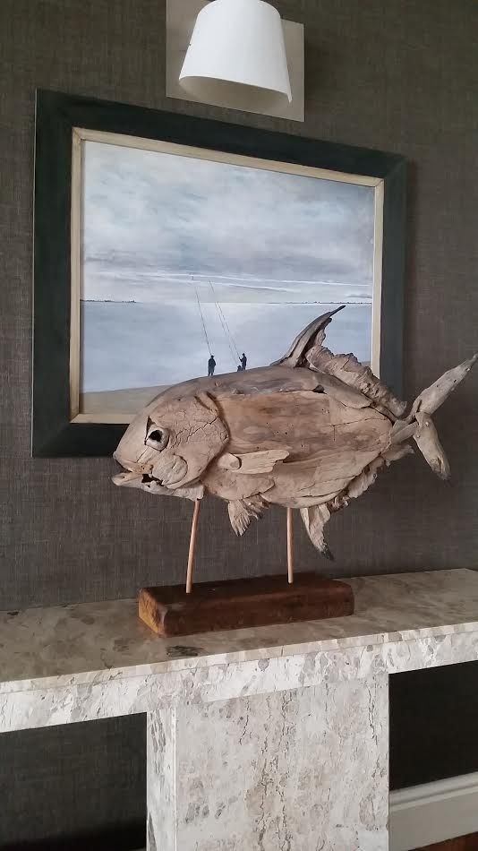 A driftwood fish make an ideal gift for the man cave. permit sculpture by Tony Fredriksson