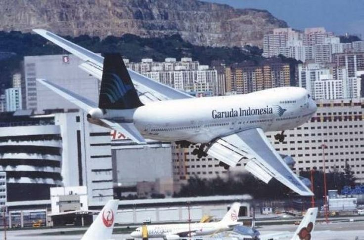 Still turning into finals over the airfield at Kai Tak. Garuda Indonesia B747.