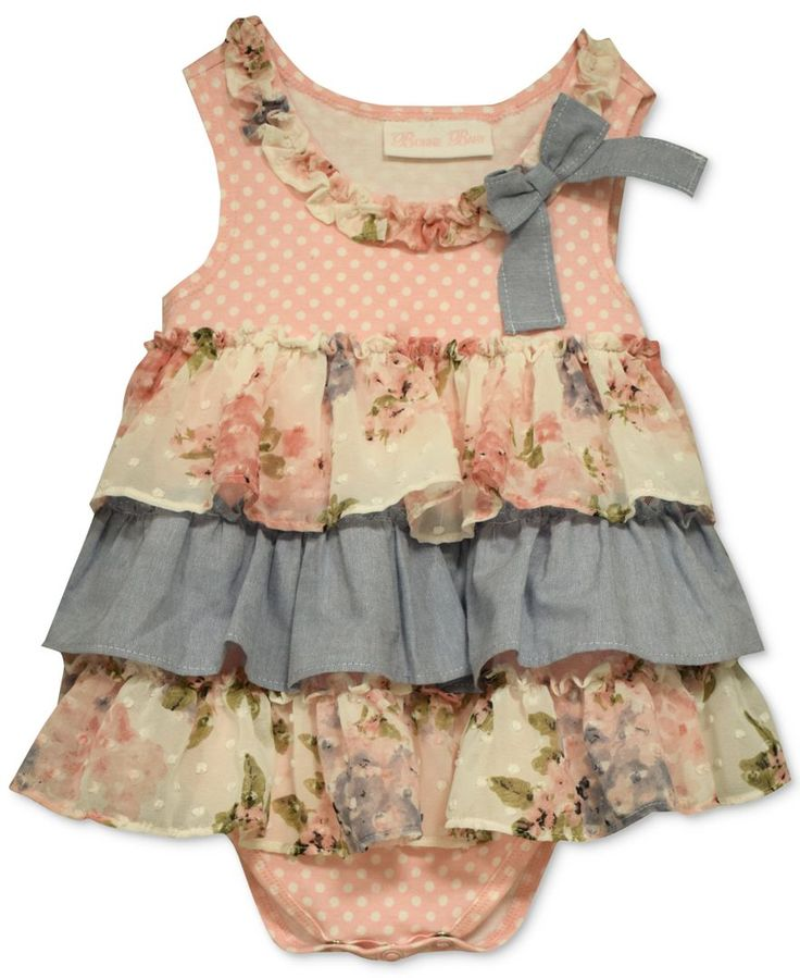 A cascade of ruffles at the skirt make this adorable dress from Bonnie Baby extra fun--and perfect for dressing baby girl for special occasions. | Cotton/polyester | Machine washable | Imported | Dot