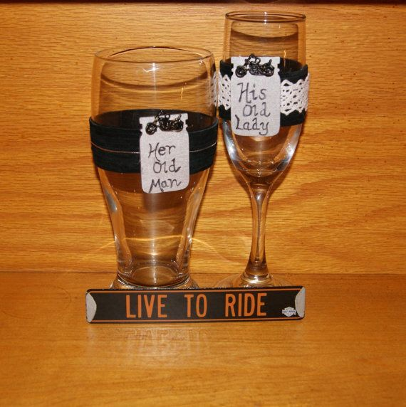 Personalized Couple / Champagne Flute and by CarolesWeddingWhimsy, This is a set of 2 Motorcycle Wedding Toasting Glasses.  It is a Black Leather and White Lace Biker Wedding Toasting Glasses. This set can be monogramed. This is for the biker and riding enthusiast.  You can find it here https://www.etsy.com/listing/259467406/personalized-couple-champagne-flute-and
