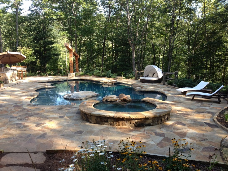 Perfectly in tune with the natural beauty of Asheville, NC this natural pool design is outfitted with Balencia chaise lounges and Baleares modular lounger for relaxing summer days.  Frontgate OASIS Pool & Beach Photo Challenge entry.