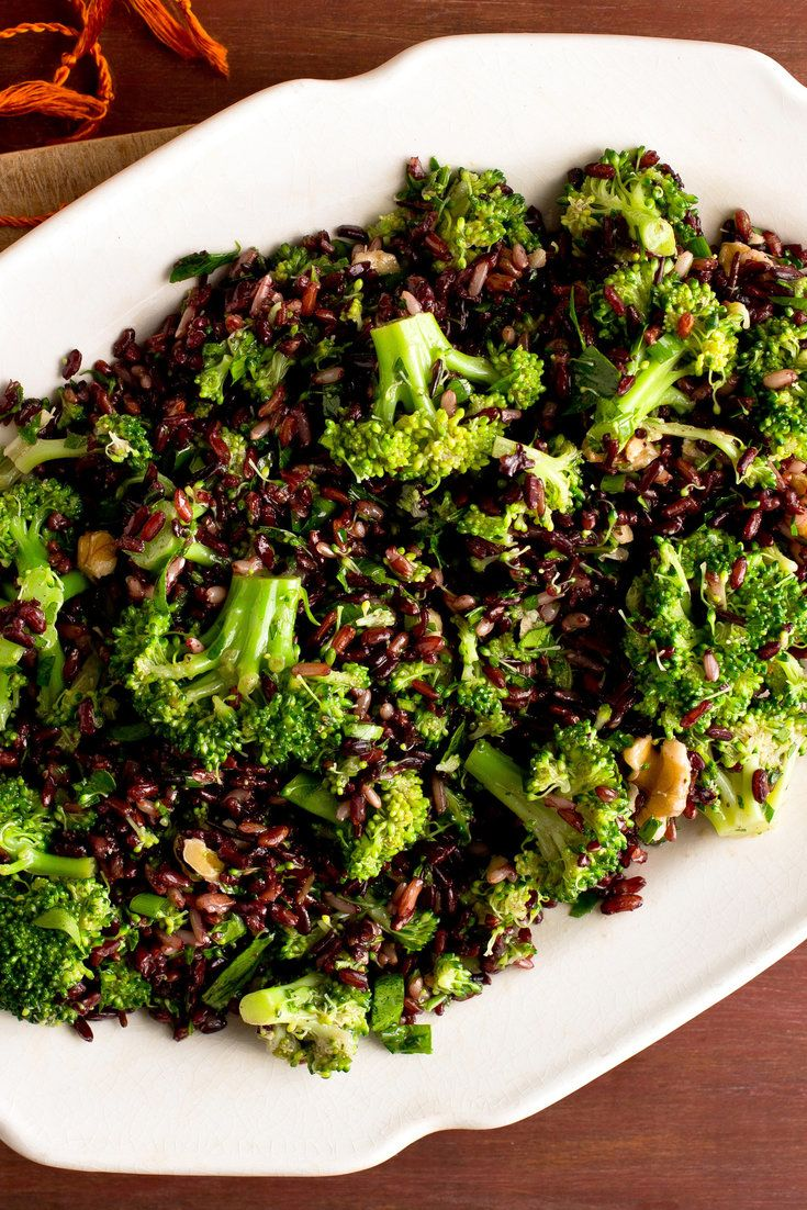 NYT Cooking: Broccoli flowers catch the nutty, lemony dressing in this winter salad.
