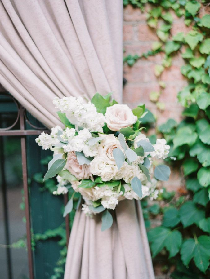 Elegant wedding florals: http://www.stylemepretty.com/illinois-weddings/chicago/2016/03/02/romantic-candle-lit-wedding-at-the-ivy-room/ | Photography: Britta Marie -http://brittamariephotography.com/