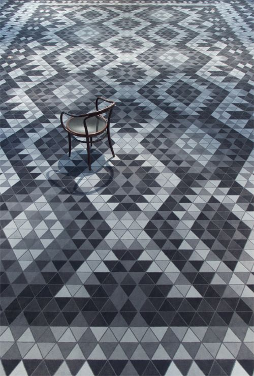 Lovely geometric floor tiles using simple triangles.
