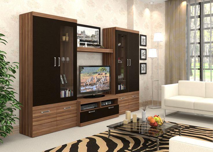Стенка Веста (2) слива/дуб ферраре - классическое интерьерное решение с двумя витринами для небольших гостиных. Прочный каркас и большое количество функциональных поверхностей, позволяют эффективно использовать пространство комнаты, не опасаясь за сохранность изделия. Классическое цветовое решение позволяет использовать эту стенку в большинстве современных дизайнерских решений, и создаёт тепло и домашний уют в вашей комнате.