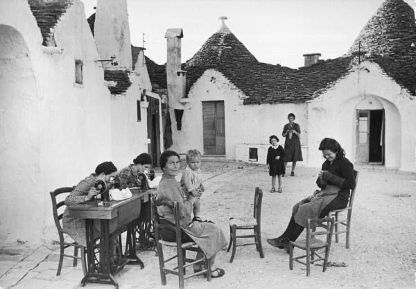 Alfred Eisenstaedt: Women sewing outside their Trulli homes. Alberobello, Italy, 1947