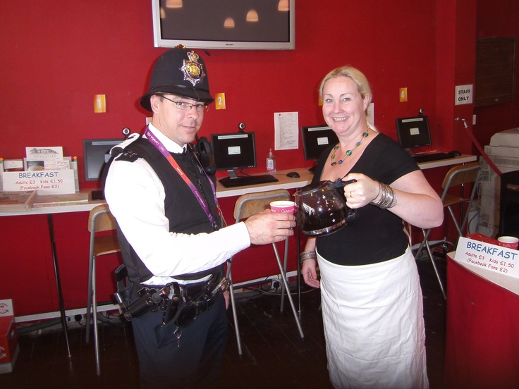 Lorraine serving up a well earned cup of coffee to our local police seargant on the morning that the Olympic Torch went past our store #olympictorch #greenwich #police #coffee