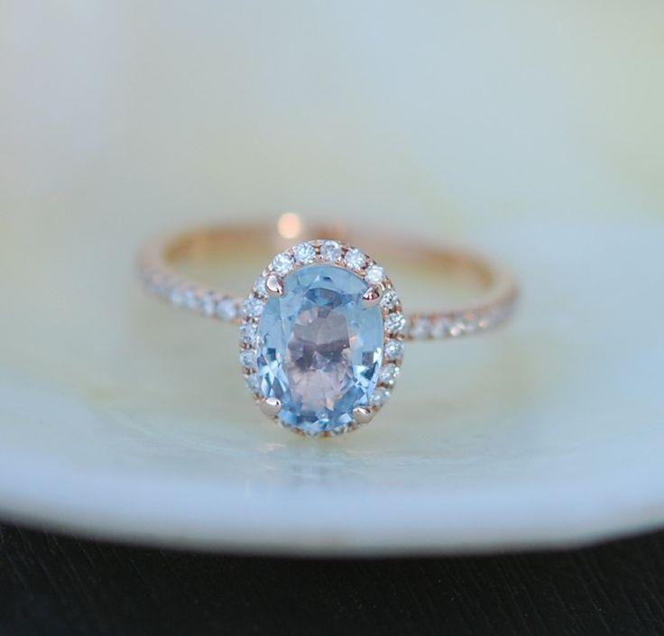 Blue green sapphire engagement ring. Caribbean blue green sapphire 1.55ct oval…