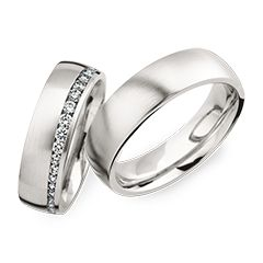 Trauringe Herrenring: Platin, Breite 6,0 mm Trauringe Damenring: Platin, Breite 6,0 mm, 40 Diamanten 0,63 ct. www.marrying.at