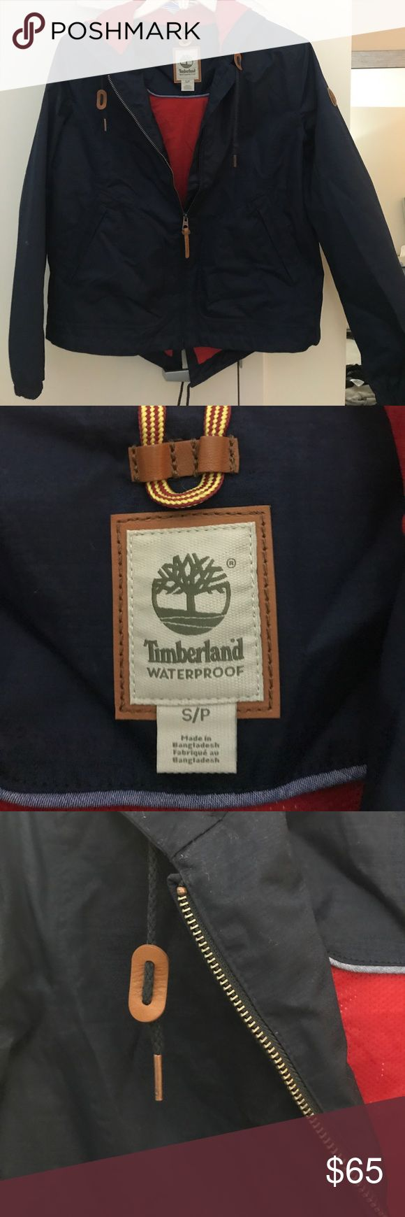 Timberland waterproof jacket Only worn once! Navy Timberland coat that has red lining and leather detailing. Great for cool nights, layering, rain, wind, etc. Timberland Jackets & Coats
