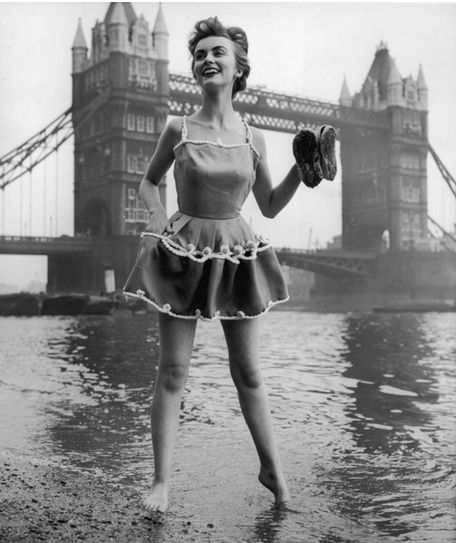 Model on the banks of the River Thames, 1954