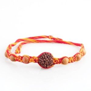 Chandan Rudraksh Rakhi Rs. 251.00 1 Punch Mukhi rudraksh Rakhi woven with sacred mauli (red and Yellow thread). These designer Astro Rakhis are hand crafted for your darling brother. Ruraksh fulfills all the desires and wishes.  #rakhionlineindia #sendonlinerakhi #buyrakhionlineindia #sendrakhitoindia