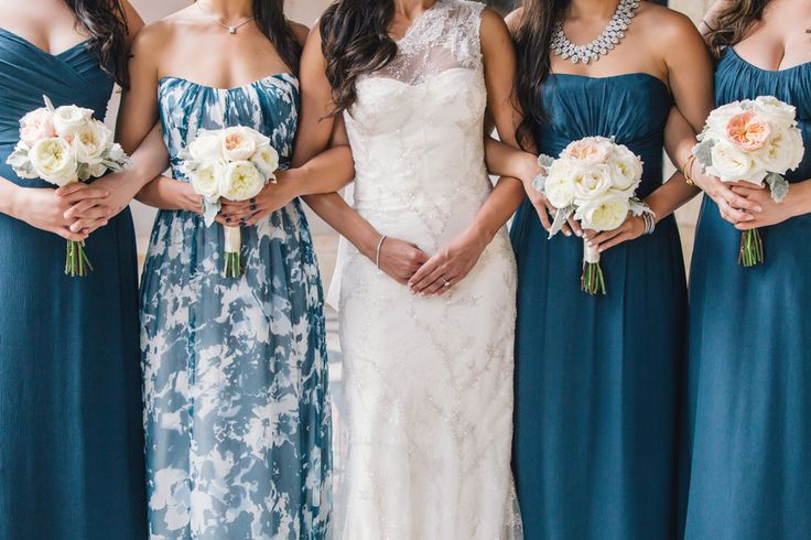 Bridesmaid dresses and floral Maid of Honor dress by Amsale in brilliant blue. #Wedding dress by Monique Lhuillier. Image by Vue Photography. #bridesmaids