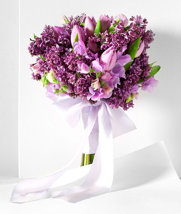 Purple lilac, lavender tulips, and lavender sweet peas wrapped in hand-dyed silk ribbon. Wedding bouquet