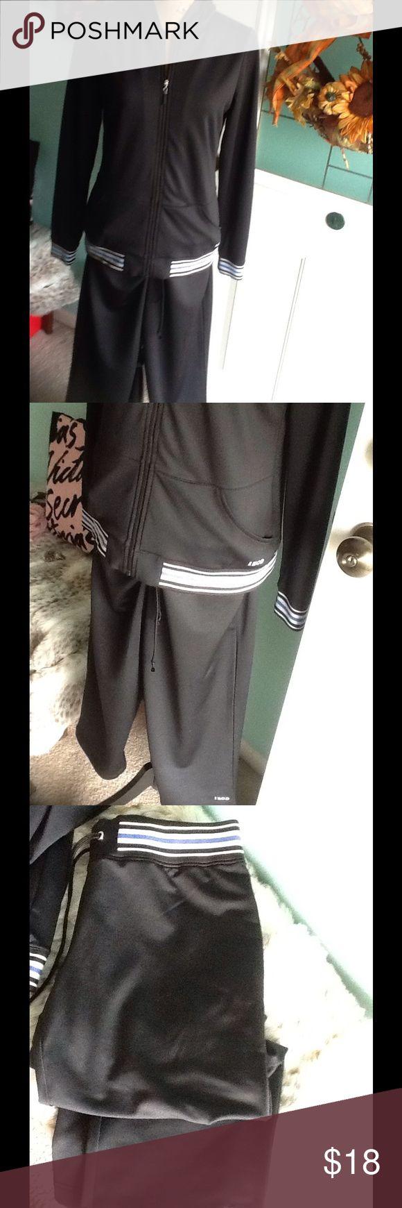 Izod track suit Zip up hoodie and Capri w/elastic,drawstring waist.black,w/blue and white trim,and blue logo.Like new. Izod Pants Track Pants & Joggers