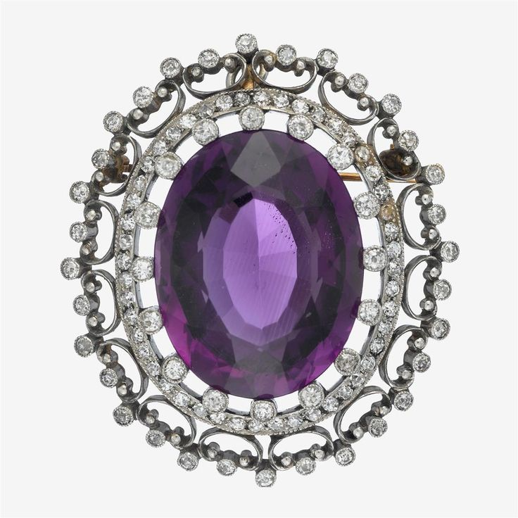 An Edwardian amethyst, diamond and platinum-topped gold pendant brooch centering an oval-cut amethyst weighing approximately: 29.75 carats; in a detailed single-cut diamond surround; total diamond weight approximately: 1.50 carats.