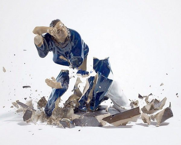 "In the photo series ""Porcelain Figurines"" by German photographer Martin Klimas, porcelain figurines are captured in the midst of shattering"
