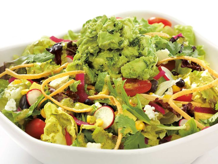 CALIFORNIA GUACAMOLE SALAD Mixed Greens, Avocado, Tomato, Corn, Black Beans, Onion, Radish, Crispy Tortillas, Feta Cheese and Cilantro Tossed with Mildly Spicy Avocado Dressing.  To find more Avocados from Mexico dishes, visit us at: http://avocadosfrommexico.com/recipe/#PFQWc28U86X1eDSl.97