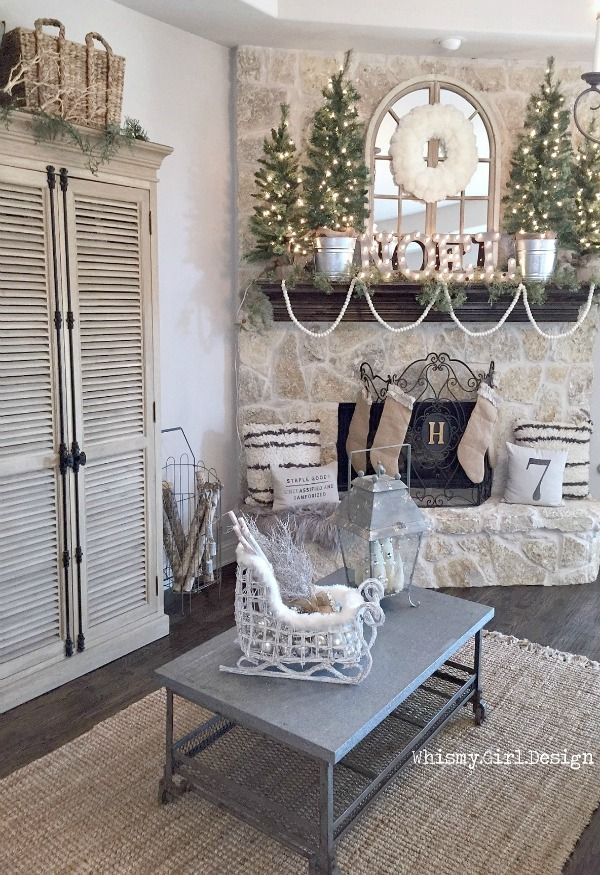 Our neutral Christmas wonderland is complete with the help of this adorable white wicker sleigh, chippy lantern and Flokati inspired pillows from HomeGoods! {Sponsored Pin}